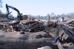 Construction equipment completes final touches to the woody fish hideouts built along the lower Yuba River as part of a pilot project by the U.S. Army Corps of Engineers Sacramento District. The project seeks to add habitat for sheltering juvenile steelhead and Chinook salmon.