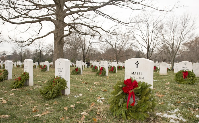 Headstones throughout Arlington National Cemetery, in Arlington Va. were adorned with wreaths during Wreaths Across America Day, Dec. 14. Fifty Marines and sailors from Marine Corps Base Camp Lejeune traveled to Arlington National Cemetery through a Single Marine Program trip to take part in the event.