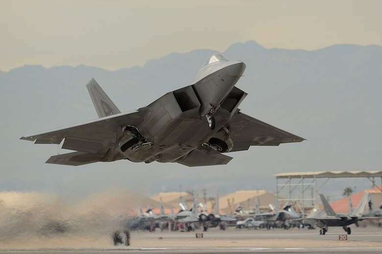 An F-22 Raptor assigned to the 154th Wing, Hawaii Air National Guard, takes off from Nellis Air Force Base, Nev., during Red Flag 13-2 on Jan. 23, 2013. Red Flag is the largest and most complex full-scale Red Flag exercise to date. Each Red Flag exercise is an advanced aerial combat training opportunity that spans two weeks and is held at Nellis or Eielson Air Force Base, Alaska. The exercises host air crews from various U.S. and allied military units and air frames. (Courtesy photo/Glenn Bloore)