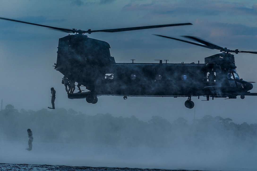 Airmen from the 23rd Special Tactics Squadron jump out the back of a MH-47 Chinook Helicopter April 9, 2013, at Wynnehaven Beach, Fla. The helicopter conducts overt and covert infiltration, exfiltration, air assault, resupply and sling-load operations in a wide range of environmental conditions. (U.S. Air Force photo/Airman 1st Class Christopher Callaway)