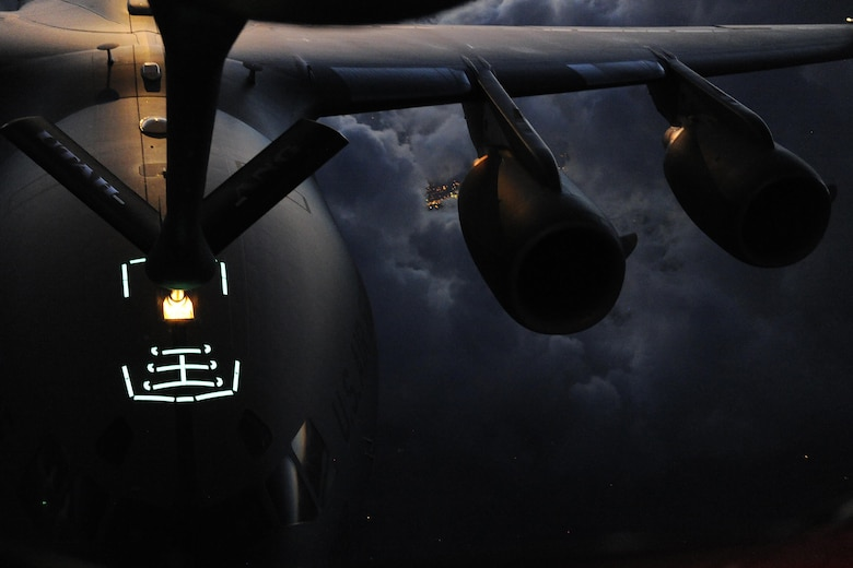 Airmen with the 151st Air Refueling Wing conduct air refueling operations with a C-17 Globemaster III assigned to Joint Base Lewis-McCord, Wash., May 9, 2013, over southern Idaho. The 151st ARW supported air operations across the western U.S. (U.S. Air Force photo/Staff Sgt. Tim Chacon)