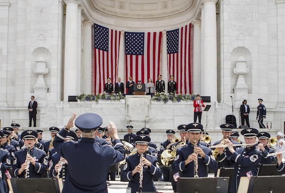 The U.S. Air Force Band plays the national anthem during a Memorial Day ceremony at the Memorial Amphitheater May 27, 2013, at Arlington National Cemetery in Arlington, Va. President Barack Obama delivered remarks during the event. (U.S. Army photo/Staff Sgt. Sean K. Harp)