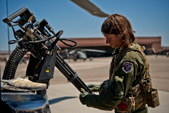 Airman 1st Class Natasha Libby examines the barrels of a Gau-2 mini gun mounted on an HH-60 Pave Hawk helicopter June 20, 2013, at Nellis Air Force Base, Nev. Libby must inspect each part of the weapons systems on the HH-60 Pave Hawk to ensure safety and proper function. Libby is a 66th Rescue Squadron aerial gunner. (U.S. Air Force photo/Senior Airman Daniel Hughes)