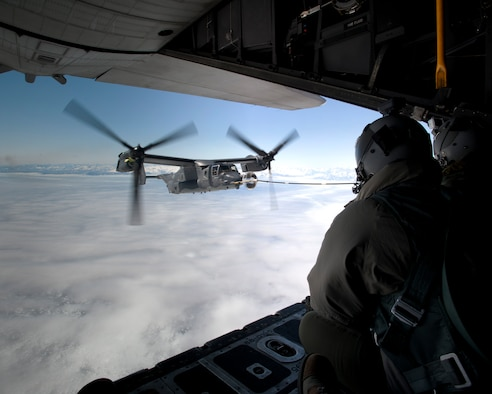 A CV-22B Osprey receives fuel June 21, 2013, off the coast of Greenland from a 7th Special Operations Squadron MC-130H Combat Talon II. The aircraft landed in Iceland during its journey to Royal Air Force Mildenhall, England, to allow for crew rest and refueling. The CV-22, assigned to the 7th SOS, is the first of 10 slated to arrive as part of the 352nd Special Operations Group expansion, which will last through the end of 2014. (U.S. Air Force photo/Senior Airman Laura Yahemiak)