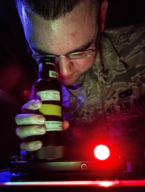 Senior Airman Nicholas Macdonald performs a night vision goggle inspection Aug. 8, 2013, at the 437th Maintenance Group Precision Measurement Equipment Laboratory at Joint Base Charleston, S.C. The Airmen from Shaw Air Force Base, S.C. conducted the training here because their night vision inspection equipment was undergoing maintenance. The Airmen confirmed that the optics in the night vision equipment work properly. Macdonald is a 20th Component Maintenance Squadron PMEL calibration technician from Shaw AFB, S.C. (U.S. Air Force photo/Senior Airman Dennis Sloan)