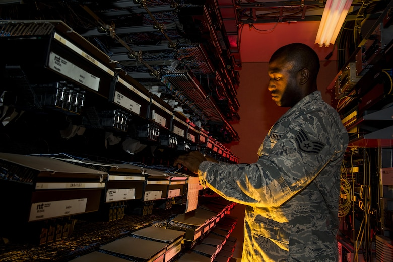 Staff Sgt. Spenser Amos finds a new number location on a line equipment number block Aug. 8, 2013, at Joint Base Charleston, S.C. The infrastructure flight maintains all communications cabling which includes copper wiring, inside building cabling, outside building cabling and all telephone switches. Amos is a 628th Communications Squadron cyber transport systems technician. (U.S. Air Force photo/Senior Airman George Goslin)