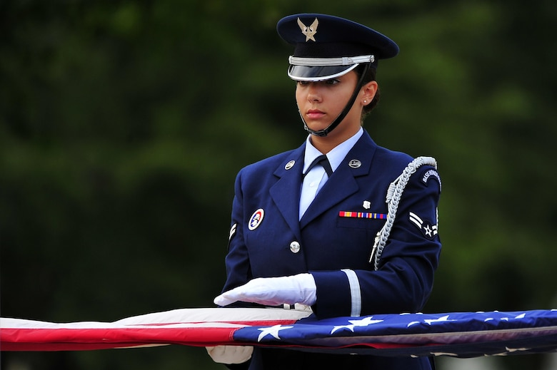 Airman 1st Class Jade Derksen helps fold the U.S. flag during the Patriot Day Retreat Ceremony Sept. 11, 2013, at Misawa Air Base, Japan. The ceremony was held to remember the nearly 3,000 who perished in the 9/11 terrorist attacks 12 years ago. Derksen is a Misawa Honor Guard member. (U.S. Air Force photo/Staff Sgt. Nathan Lipscomb)