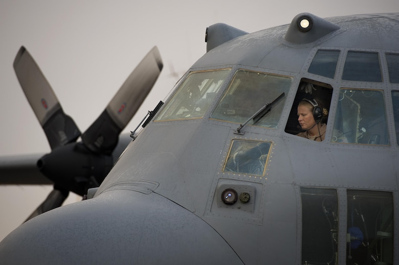 Maj. Erin Kelley preflights a C-130H Hercules cargo plane Oct. 28, 2013, before embarking on a retrograde mission to Baghdad International Airport, Iraq. The 737th Expeditionary Airlift Squadron is assigned to the 386th Air Expeditionary Wing and is a tactical airlift hub responsible for transporting passengers and cargo across U.S. Central Command. Kelley is a 737th Expeditionary Airlift Squadron pilot and a Kalamazoo, Mich. native. She is deployed from the 176th Wing, Alaska Air National Guard. (U.S. Air Force photo/Master Sgt. Ben Bloker)
