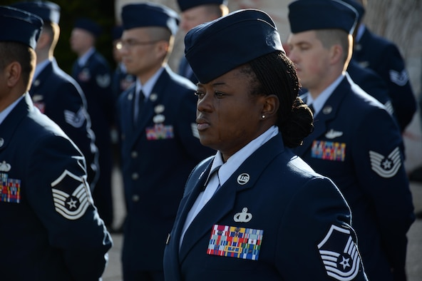 Master Sgt. Shaneeka Jones stands at parade rest during a Veterans Day memorial ceremony Nov. 11, 2013, at the Henri-Chapelle American Cemetery and Memorial in Belgium. More than 40 American service members participated in the ceremony before nearly 100 attendees to honor the service and sacrifice of American veterans. Jones is the superintendent of flight records from the 470th Air Base Squadron at NATO Air Base Geilenkirchen, Germany.