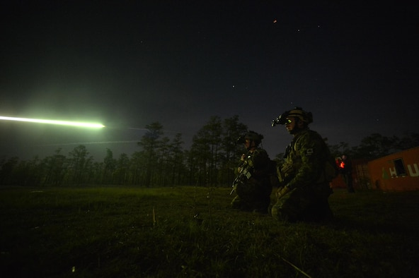 Canadian special operation regiment members call in close-air support from their U.S. Air Force allies during Emerald Warrior 2013 April 26, 2013, at Hurlburt Field, Fla. The primary purpose of Emerald Warrior is to exercise special operations components in urban and irregular warfare settings to support combatant commanders. Emerald Warrior leverages lessons from Operation Iraqi Freedom, Operation Enduring Freedom and other historical lessons to provide better trained and ready forces to combatant commanders. (U.S. Air Force photo/Senior Airman Matthew Bruch)