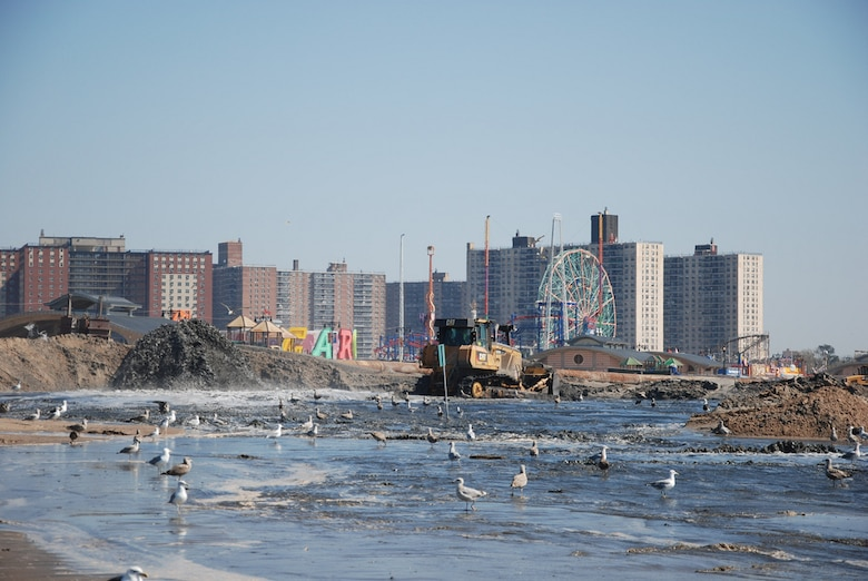 Coney Island landmarks are visible as crews work to place sand and restore the beach at Coney Island Friday September 20, 2013. The U.S. Army Corps of Engineers is placing roughly 600,000 cubic yards of sand at Coney Island to replace sand lost during Hurricane Sandy and also to restore the Coney Island project to its original design profile from when the coastal storm risk reduction project (primarily the beach) was originally constructed in the 1990s. While the beach is a tremendous recreational asset, it's important to note that the engineered beach is designed to act as a buffer and reduce risks to the community from coastal storms like Hurricane Sandy.