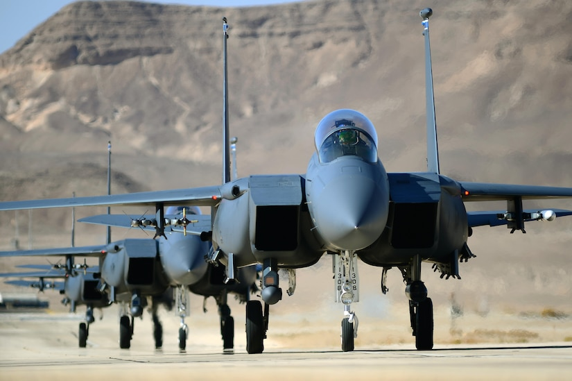 A group of F-15E Strike Eagles taxi following a training combat mission Nov. 26, 2013, during Blue Flag exercise on Uvda Air Force Base, Israel. Aircraft from the 492nd Fighter Squadron, Royal Air Force Lakenheath, England, deployed to participate in the exercise, where they engaged multiple heavy air defense assets, ground base targets and simulated opposition forces to meet combined operations requirements. (U.S. Air Force photo/Master Sgt. Lee Osberry)