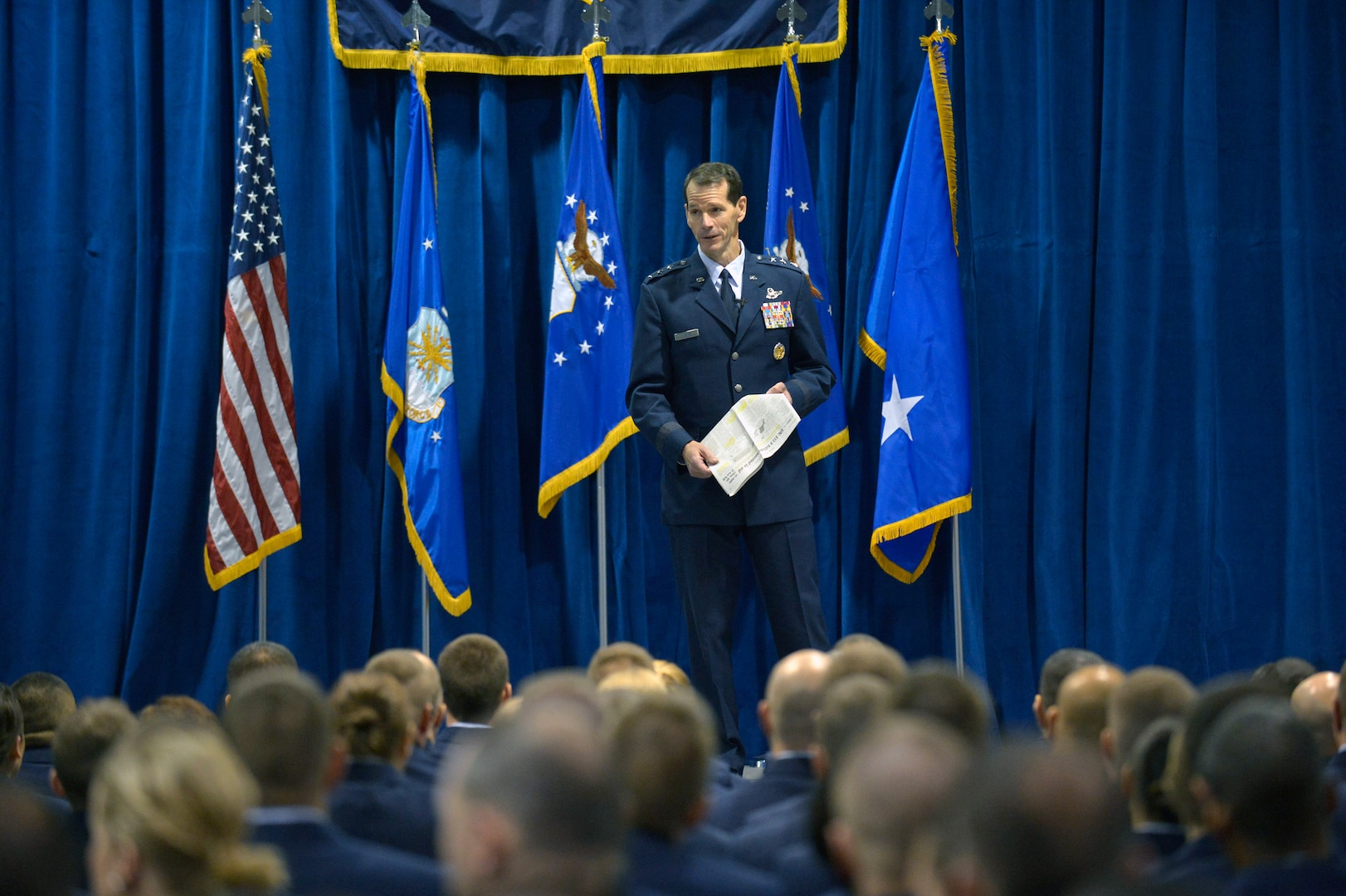 Lt. Gen. Stanley E. Clarke III, director of the Air National Guard, visits with members of the I.G. Brown Air National Guard Training and Education Center Dec. 19, 2013, to gain a better understanding of their missions.