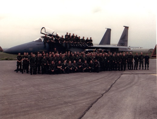 Over 90 Oregon Air Guard members of the 142nd Fighter Wing, the bulk of the third of three two-week rotations, pose for a photo with a 123rd Fighter Squadron F-15A Eagle during their deployment in support of Operation NORTHERN WATCH in early 1998.  This was the first operational deployment for the unit since the 1951 call-up during the Korean War. (photograph from the 142nd Fighter Wing Public Affairs Office)