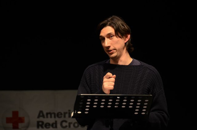 "Actor and U.S. Marine Corps veteran Adam Driver connects with the audience as he performs a monologue from Sam Shepard's play, ""Curse of the Starving Class,"" during the Arts in the Armed Forces performance at the Grafenwoehr Performing Arts Center in Germany, Dec. 18, 2013."