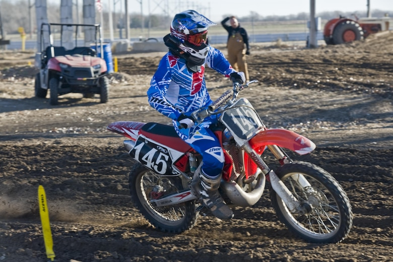2nd Lt. Michael Reardon rides through a turn on his dirt bike during a race in Maize, Kan. Reardon is the deputy chief of program development with the 22nd Civil Engineer Squadron at McConnell Air Force Base, Kan.