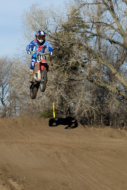 2nd Lt. Michael Reardon jumps on his dirt bike, Dec. 15, 2013, during a race in Maize, Kan. Reardon is the deputy chief of program development with the 22nd Civil Engineer Squadron at McConnell Air Force Base, Kan. Motocross is one of many outdoor activities Reardon engages himself in, including: snowboarding, competitive pistol shooting and team sports.