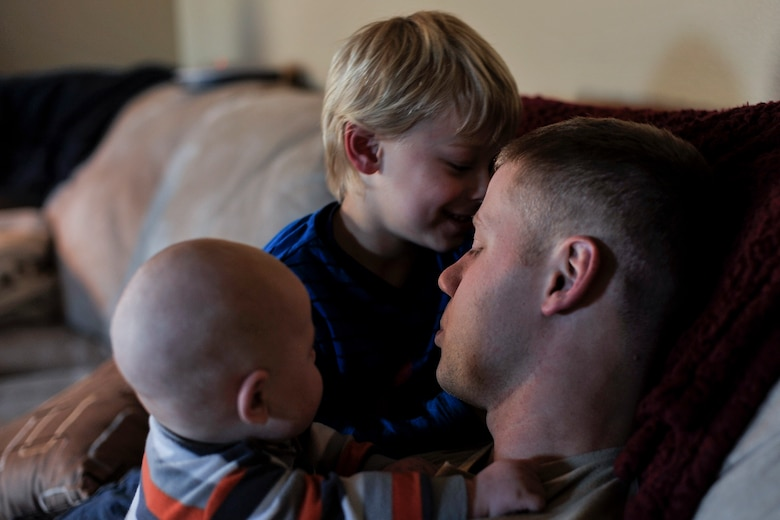Tech. Sgt. Aaron Drain holds his sons, Ayden and Everett, on his first day home from a deployment to Afghanistan Jan. 23, 2013, in Cabot, Ark. Drain said he felt the need to tread lightly at first, and slowly work his way back into the boy's lives. (U.S. Air Force photo by Staff Sgt. Russ Scalf)