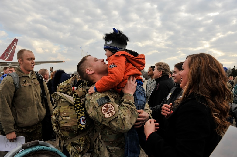 Tech. Sgt. Aaron Drain holds his son, Ayden, at a redeployment event on the flight line Jan. 23, 2013, at Little Rock Air Force Base, Ark. Drain said seeing his family again was an emotional event, and the entire experience of the deployment helped him realize the importance of family. (U.S. Air Force photo by Staff Sgt. Russ Scalf)