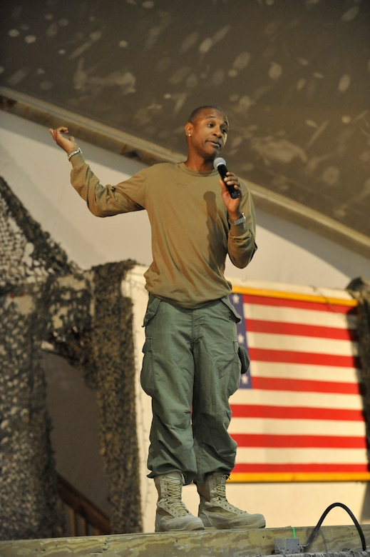 Comedian Tommy Davidson performs for deployed Service members on New Year's Eve at Bagram Airfield, Afghanistan, Dec. 31, 2013.(U.S. Air Force photo by Senior Master Sgt. Gary J. Rihn/Released)