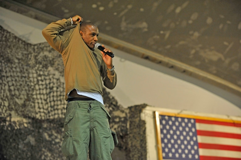 Comedian Tommy Davidson performs his comedy show for deployed Service members on New Year's Eve at Bagram Airfield, Afghanistan, Dec. 31, 2013.(U.S. Air Force photo by Senior Master Sgt. Gary J. Rihn/Released)