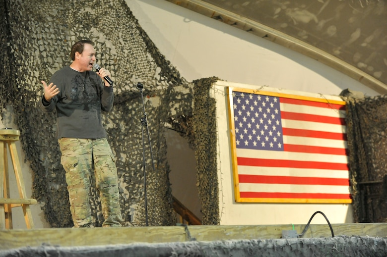 Comedian Rob Maher performs for deployed Service members on New Year's Eve at Bagram Airfield, Afghanistan, Dec. 31, 2013. Maher was touring with fellow comedian Tommy Davidson.(U.S. Air Force photo by Senior Master Sgt. Gary J. Rihn/Released)