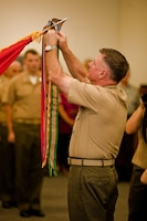 Lt. Gen. Terry G. Robling, commander of U.S. Marine Corps Forces, Pacific, attaches a Meritorious Unit Commendation streamer with a bronze star to the MarForPac colors here Feb. 1. Marines at MarForPac were awarded a MUC for spearheading the Corps' rebalance toward Asia-Pacific from Sep. 1, 2010 to Aug. 31, 2012.