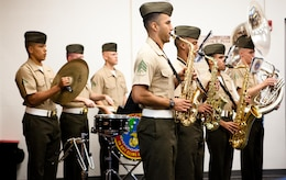 The U.S. Marine Corps Forces, Pacific Band plays music before the awards and promotions formation here Feb. 1. MarForPac also held a streamer ceremony for their recently-awarded Meritorious Unit Commendation at the formation.