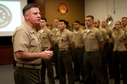 "Lt. Gen Terry G. Robling, commander of U.S. Marine Corps Forces, Pacific, addresses Marines under his command after a streamer ceremony for their recently-awarded Meritorious Unit Commendation here Feb. 1. MarForPac was awarded the MUC for spearheading the Corps' rebalance toward Asia-Pacific from Sep. 1, 2010 to Aug. 31, 2012. ""I'm proud of all of you,"" Robling said. ""You've received this MUC for all the work that you've done the last two years."""