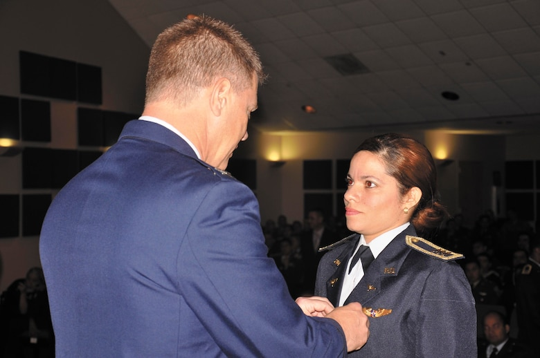 Tejada-Quintana, right, receives an award during graduation from the ISOS at IAAFA.  (U.S. Air Force photo by Staff Sgt. Delia Marchick)