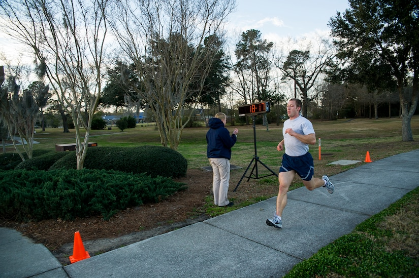Senior Airman Joseph Schlank, 437th Aerial Port Squadron passenger service agent, crosses the finish line during the Commander's Challenge Run Feb. 1, 2013, at Joint Base Charleston – Air Base, S.C. Schlank finished with a time of 18 minutes, 16 seconds. The Commander's Challenge is held monthly to test Team Charleston's fitness abilities. (U.S. Air Force photo/ Senior Airman George Goslin)