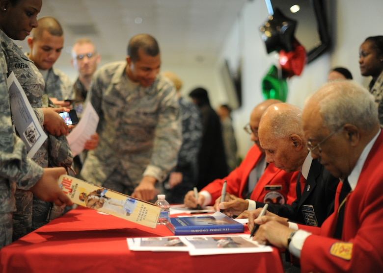 Tuskegee Airmen sign autographs for service members during the Black History Month Opening Breakfast at Joint Base Andrews, Md., Feb. 1, 2013. This free event kicked-off BHM and featured guest speaker Dr. Roscoe C. Brown Jr., who was a former Tuskegee Airman. (U.S. Air Force photo/ Staff Sgt. Nichelle Anderson)