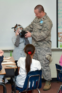 National Guard Major Doug Robertson makes a presentation during career day, February 01, 2013 at Dr. George Washington Carver Elementary School in Richmond Hill, Ga. Robertson demonstrated the procedure for donning a gas mask and answered questions from students in Mrs. Rachel Mahon's fifth grade class. (National Guard photo by Tech. Sgt. Charles Delano/released)