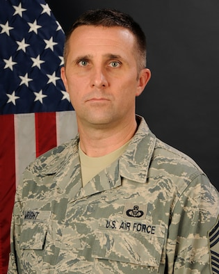 Chief Master Sgt. Robert Wright, with the 169th Operations Support Flight at McEntire Joint National Guard Base, S.C., poses for his official portrait Jan. 11, 2013.