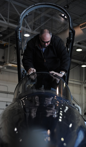 WHITEMAN AIR FORCE BASE, Mo. -- Russ Cass, M1 Support services aircraft mechanic, performs a post-flight inspection on a T-38 Talon, Jan. 23. The post-flight inspection helps aircraft mechanics find malfunctions in various aircraft components that might have occurred during flight. (U.S. Air Force photo/Staff Sgt. Nick Wilson) (Released)
