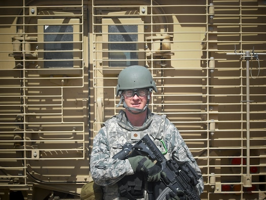 Lt. Col. Ed Dagney, 177th Comptroller Flight Commander, poses in front of a Mine Resistant Anti-Personnel (MRAP) vehicle in Afghanistan.  Courtesy photo.