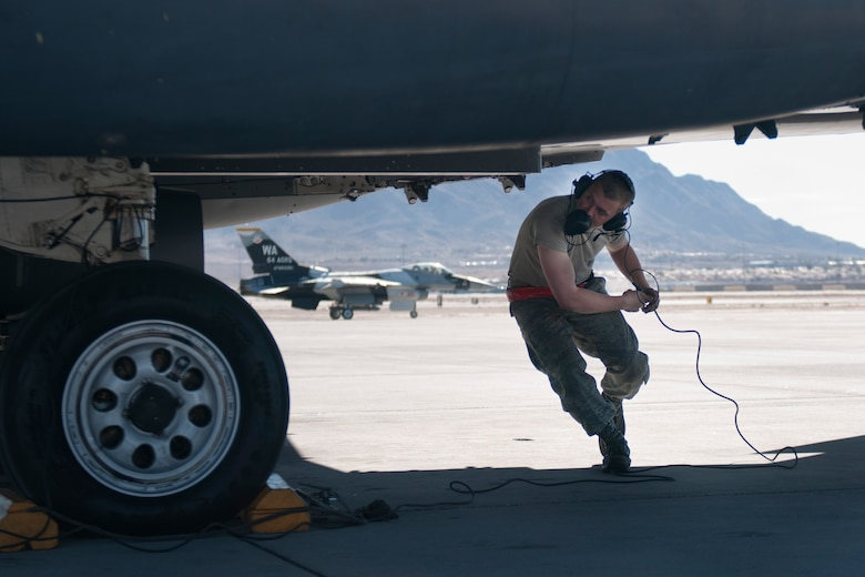 U.S. Air Force Airman 1st Class Justin Brant, 389th Aircraft Maintenance Unit crew chief, competes pre-flight checks on an F-15E Strike Eagle Feb 1, 2013, at Nellis Air Force Base, Nev. Red Flag provides valuable training and experience to prepare Airmen for future deployments. (U.S. Air Force photo/Senior Airman Heather Hayward)