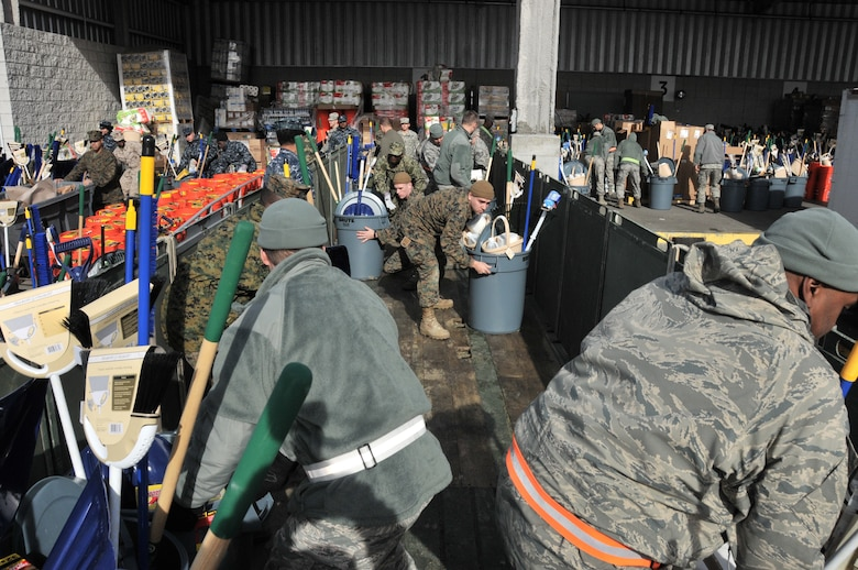 MANHATTAN, NY –Deployed members of the 105th Airlift Wing assist Army Guard, Naval Militia Sailors and Marines in loading Relief supplies awaiting transport at the Joint Services Distribution Site, Jacob Javits Convention Center loading dock Nov. 8, 2012. (National Guard photo by Tech. Sgt. Michael OHalloran)(Released)