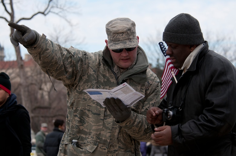 Senior Master Sgt. Daryl Ferricks, 171st Air Refueling Wing, Pennsylvania Air National Guard, provides directions to a 57th Presidential Inauguration attendee in Washington, D.C., Jan. 21, 2013. More than 6,000 Soldiers and Airmen were sworn in as special police to help local and federal law enforcement with traffic and crowd control throughout the 2013 Presidential Inauguration. (Air National Guard photo by Senior Airman Andrea F. Liechti)