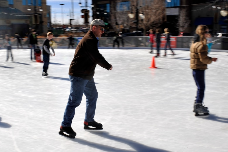 Lt. Col. Hew Wells, 460th Space Communications Squadron commander, skates during an event for families of deployed service members Feb. 2, 2013, at the Southlands Pond. Nearly 50 family members turned out for the free skating event hosted by the Airman and Family Readiness Center. (U.S. Air Force photo by Airman 1st Class Riley Johnson/Released)