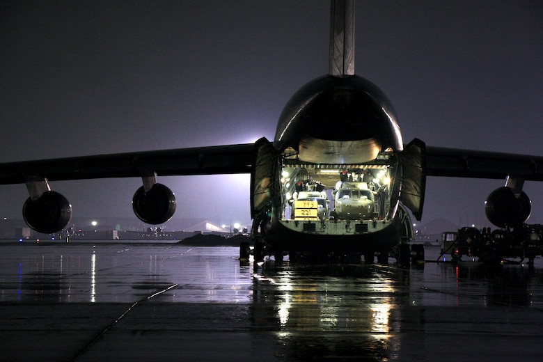 A C-5M Super Galaxy waits to be loaded with cargo at Bagram Air Field, Afghanistan. The C-5M Super Galaxy has served the U.S. Air Force since 1969, and continues to provide vital heavy air lift to troops worldwide. (U.S. Army photo/1st Lt. Henry Chan, 18th Combat Sustainment Support Battalion Public Affairs)