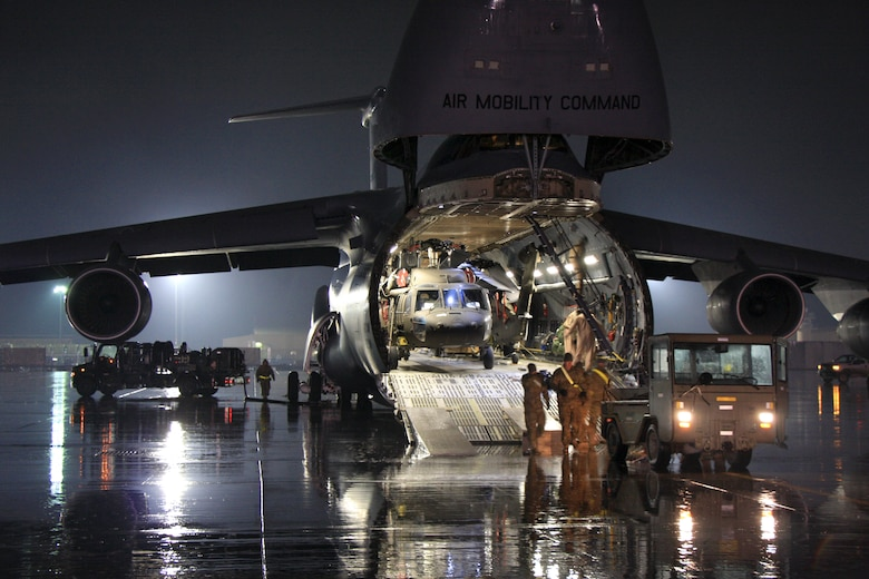 UH-64 Black Hawk helicopters await offload from a C-5M Super Galaxy at Bagram Air Field. The C-5M Super Galaxy has served the U.S. Air Force since 1969, and continues to provide vital heavy air lift to troops worldwide. (U.S. Army photo/1st Lt. Henry Chan, 18th Combat Sustainment Support Battalion Public Affairs)