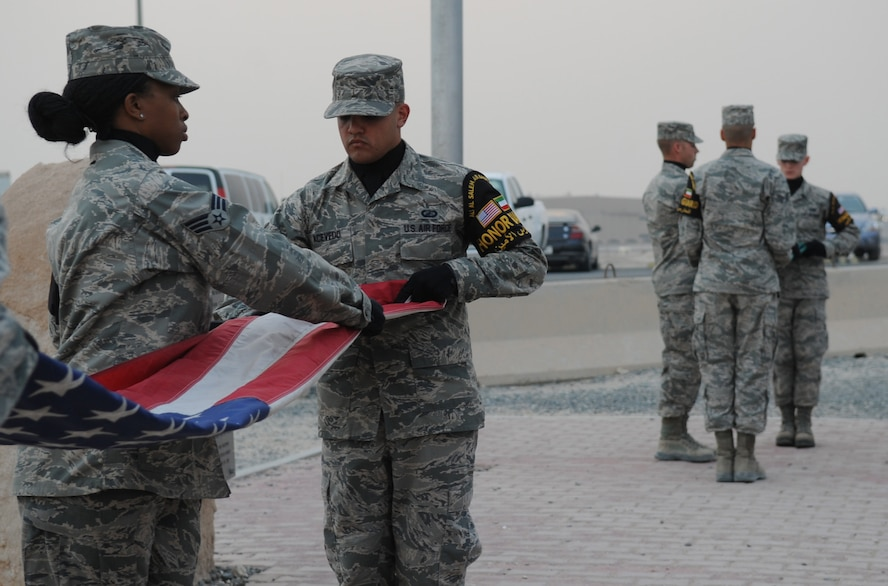 SOUTHWEST ASIA – Senior Airman Gaetano Acevedo, 509th Contracting Squadron, volunteers as a member of the base honor guard on his deployment in Southwest Asia. Acevedo is currently deployed for a six-month rotation to the 386th Expeditionary Civil Engineer Squadron force protection security escort flight. Acevedo's role in force protection is Pass and ID liaison. He ensures all contractors have a reason to be on base. He also takes time out of his schedule to be a part of the honor guard team and the Rising IV, a deployed Airmen's Council. (U.S. Air Force photo/Staff Sgt. Alexandra M. Boutte) (RELEASED)