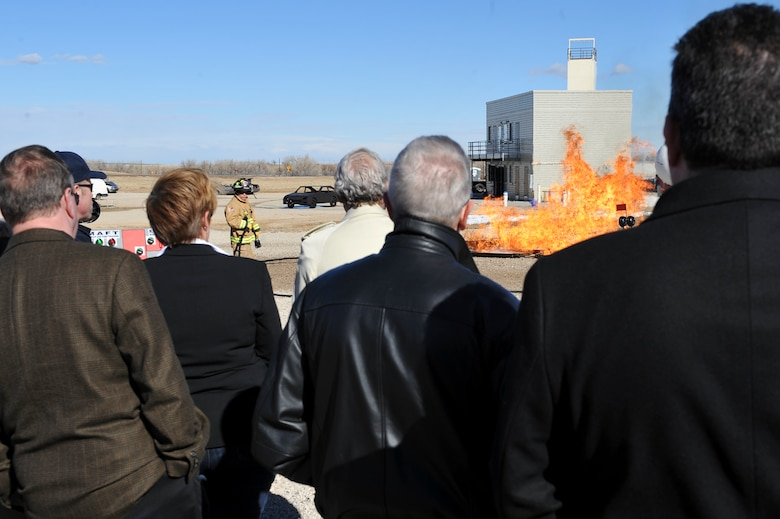 Participants of Mayors' Day view a demonstration by the 460th Civil Engineer Squadron firefighters Feb. 1, 2013, at the Buckley Air Force Base fire training ground. This was one of several demonstrations given to local Colorado mayors during Mayors' Day. (U.S. Air Force photo by Airman 1st Class Phillip Houk/Released)