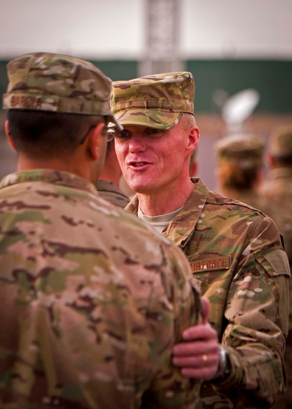 Chief Master Sgt. of the Air Force James Cody visits with an Airman at Kandahar Airfield, Afghanistan, Feb. 4. Cody and Air Force Chief of Staff Gen. Mark Welsh III visited KAF to thank the Airmen here for their service and to discuss their priorities for the Air Force. (U.S. Air Force photo/Senior Airman Scott Saldukas)