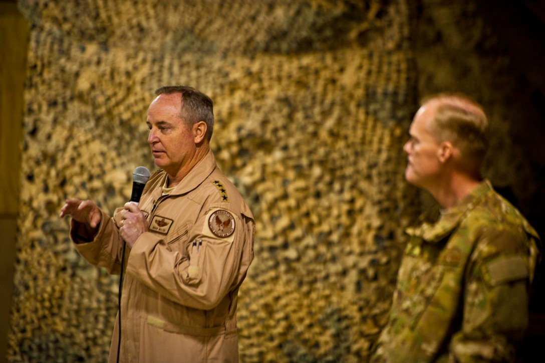 "Air Force Chief of Staff Gen. Mark A. Welsh III speaks to Airmen at Kandahar Airfield, Afghanistan, Feb. 4. Welsh and Chief Master Sgt. of the Air Force James Cody visited KAF to thank the Airmen for their service and to discuss their priorities for the service. ""We just want you to know that we're proud of you,"" the general said. ""We want you to know that you make us look good each and every day, so thank you for that. More importantly, you make the nation look good every day. That's what's really important about what you're doing."" (U.S. Air Force photo/Senior Airman Scott Saldukas)"