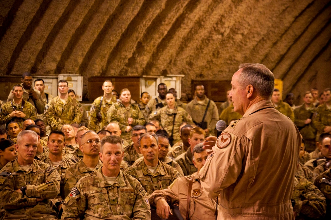 "Air Force Chief of Staff Gen. Mark A. Welsh III speaks to Airmen at Kandahar Airfield, Afghanistan, Feb. 4. Welsh and Chief Master Sgt. of the Air Force James Cody visited KAF to thank the Airmen for their service and to discuss their priorities for the service. ""Thanks for everything you do,"" the general said during an Airman's Call. ""Thanks for making us proud to come to work every day. It is such a privilege to stand beside you guys."" (U.S. Air Force photo/Senior Airman Scott Saldukas)"