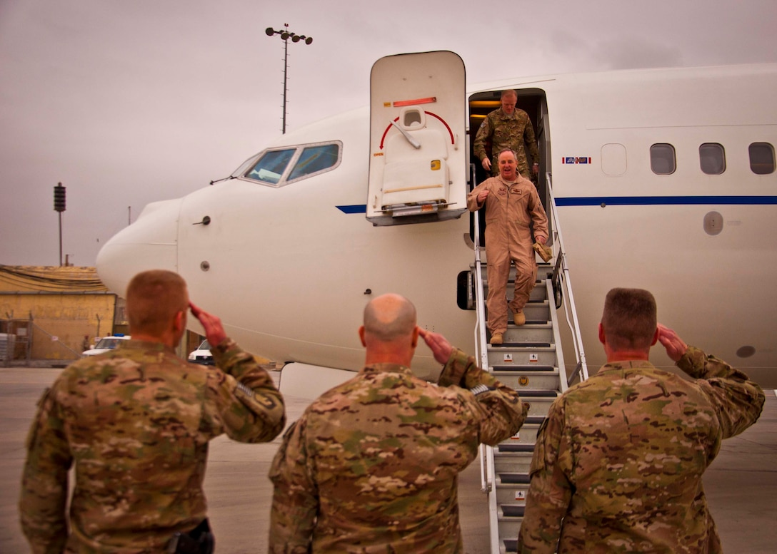 Air Force Chief of Staff Gen. Mark A. Welsh III and Chief Master Sgt. of the Air Force James Cody are greeted by (left to right) Col. Case Cunningham, 451st Air Expeditionary Wing vice commander, Chief Master Sgt. David Brinkley, 451st AEW command chief, and Brig. Gen. John Dolan, 451st AEW and KAF commander, upon arriving at Kandahar Airfield, Afghanistan, Feb. 4. Welsh and Cody visited KAF as a part of a multi-base tour to meet with Airmen throughout the U.S. Central Command area of responsibility. (U.S. Air Force photo/Senior Airman Scott Saldukas)