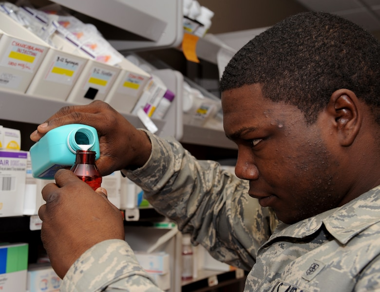 Senior Airman Roger Ruffin, 2nd Medical Support Squadron pharmacy technician, compounds prescription medication at the base pharmacy on Barksdale Air Force Base, La., Feb. 4. The base pharmacy is in charge of handling all medications needed to treat the active duty and reserve population of Barksdale and retirees in the local community. (U.S. Air Force photo/Airman 1st Class Benjamin Gonsier)