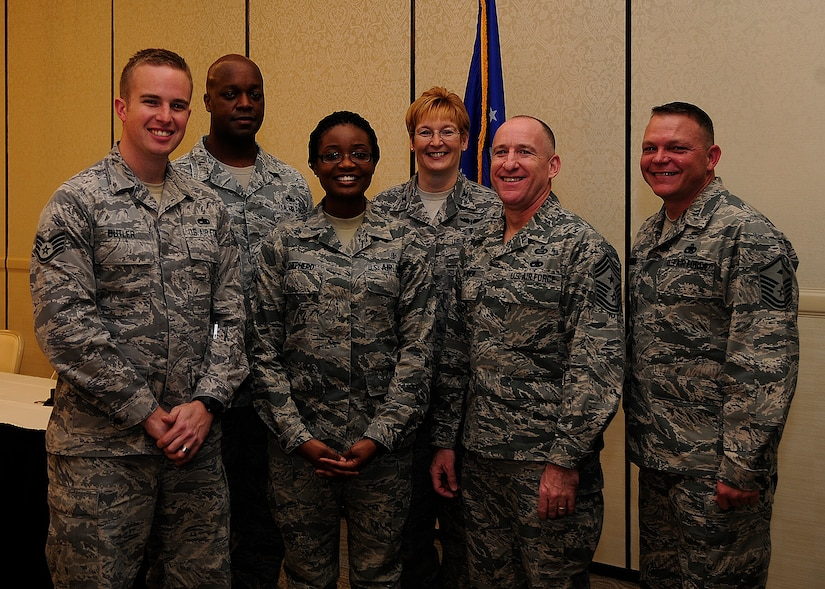 Diamond Sharp winners gather after a ceremony recognizing their accomplishments Feb. 4, 2013, at the Charleston Club at Joint Base Charleston – Air Base, S.C. (Left to right) Staff Sgt. Kristan Butler, 373rd Training Squadron instructor and Diamond Sharp recipient, Master Sgt. Julius Walker, 373rd TRS first sergeant, Airman 1st Class Amber Shepherd, 628th Medical Group and Diamond Sharp recipient, Col. Judith Hughes, 628th MDG commander, Chief Master Sgt. Al Hannon, 628th Air Base Wing command chief, and Master Sgt. Kevin Brown, 628th MDG first sergeant. Diamond Sharp awards are designed to recognize individuals in a unit who stand out to their first sergeant. (U.S. Air Force photo/Staff Sgt. Rasheen Douglas)